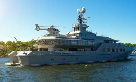 Private luxury ship with helipad in the coastal waters. Stok Fotoğraf - 129934306