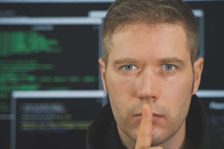 Handsome hacker portrait. Hacking and internet security concept.