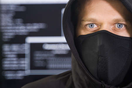 Hacker in black mask. Hacking and internet security concept.
