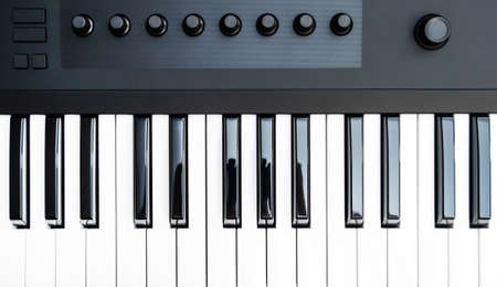 Professional midi keyboard synthesizer with knobs and controllers. Top view. 写真素材