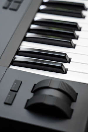 Professional midi keyboard synthesizer with knobs and controllers. Modulation and pitch wheels.