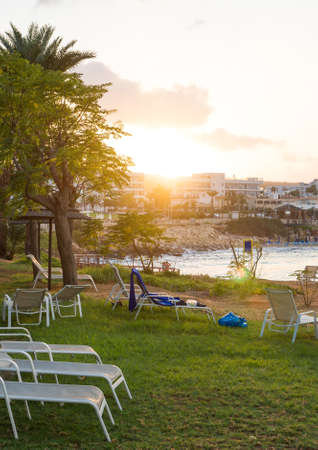 Sunbeds in front of Fig Tree Beach in Protaras on sunset. 写真素材