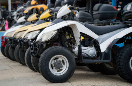 All terrain vehicles on the street. ATV rentals.