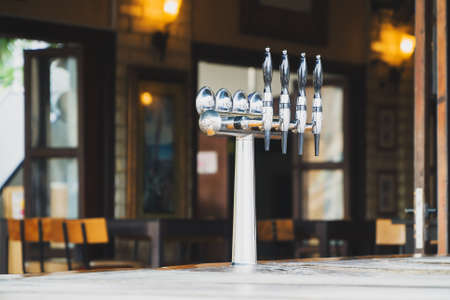 Beer tap at the bar in a restaurant.