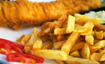 Street food. Breaded cod fillet with french fries. Stock Photo