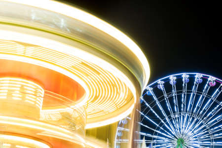 Carousel in the city park at night. Long exposure.