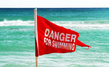 Danger for swimming red flag on the beach. Stock fotó