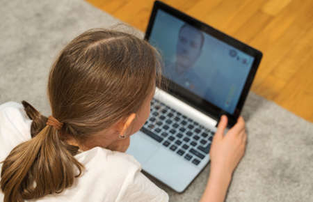 Daughter communicate with her father. Video call. Stock Photo