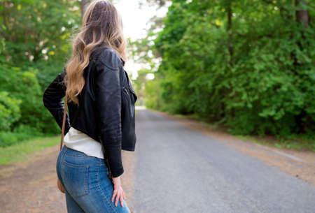 Female standing near the road. Archivio Fotografico