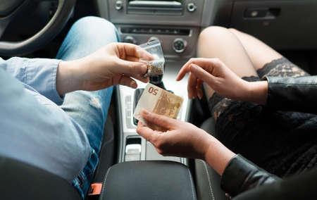 Drug dealer sells weeds to a inside the car.