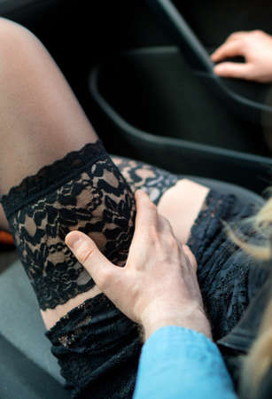 Female prostitute in and her client inside the car. Archivio Fotografico