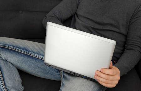 Man watching adult video on laptop pc. Stock Photo