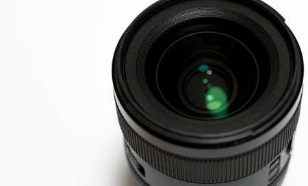 Close-up of digital camera lens on white background. Stock Photo