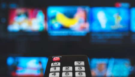 Remote control pointing on Smart TV. Archivio Fotografico
