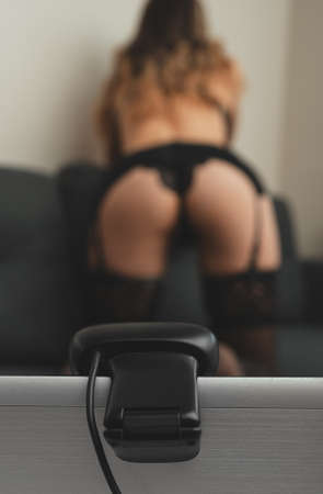 Seductive woman working as webcam model.