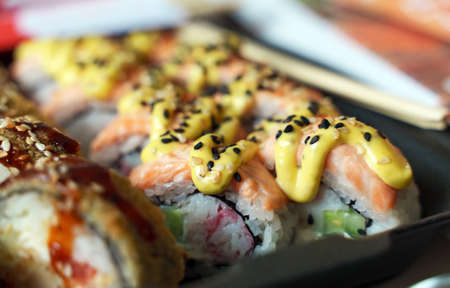 Box with tasty sushi rolls. Home food delivery. Standard-Bild
