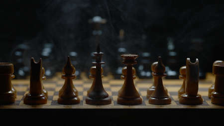 Illuminated chess with smoke effect. Suitable for commercials. Фото со стока