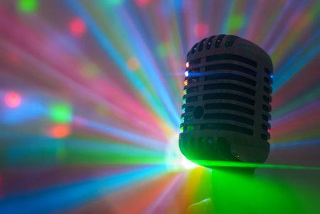 Singer holding retro microphone. Live performance or karaoke concept.