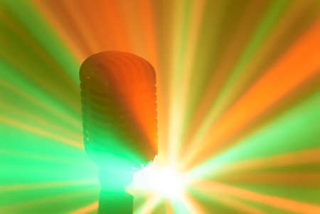 Vintage microphone with stage disco lights. Live performance or karaoke concept.