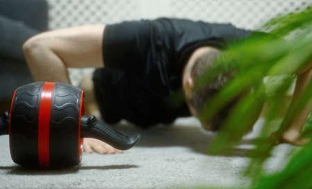 Man doing push-ups at home. Sports activities at home.
