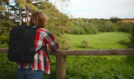 Male tourist with backpack enjoying the nature.