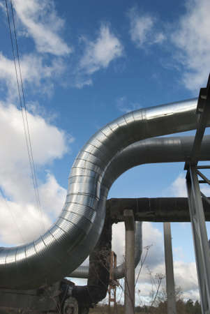 industrial pipelines on pipe-bridge against blue sky. photo