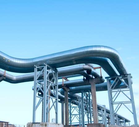 industrial pipelines on pipe-bridge against blue sky. Stock Photo - 6643014