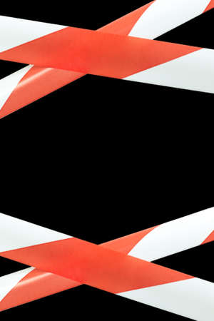 Red and white lines of barrier warning tape forbids passage. No entry concept, vertical photo with copy space Archivio Fotografico