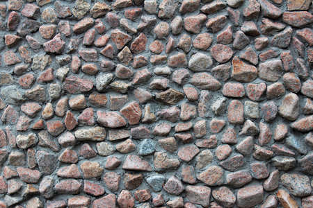 Gravel stone wall background and texture