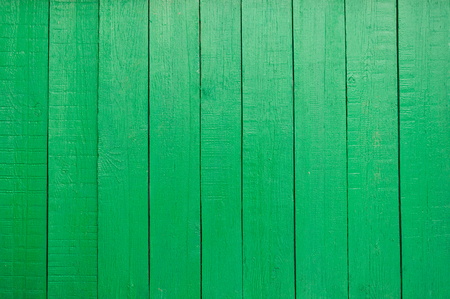 Wooden fence painted in green, texture.