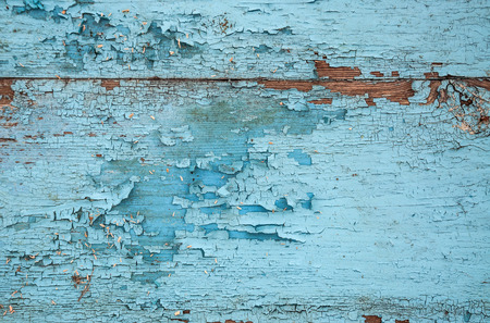 Texture of old, shabby, green paint on boards