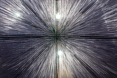 Abstract, illuminated ceiling of polycarbonate rods