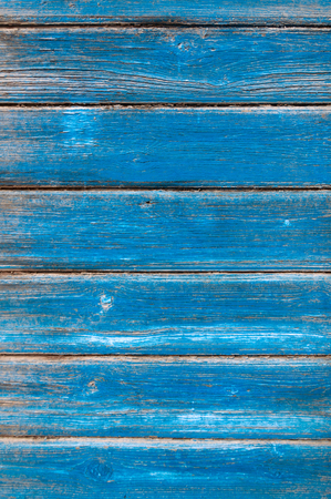 Texture horizontal wood cladding house with shabby blue paint. Stock Photo