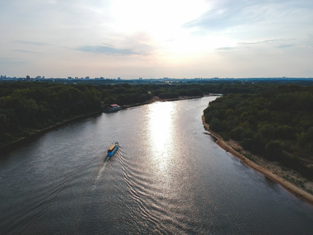 View from the height of a floating ship on the river, around the forest 版權商用圖片
