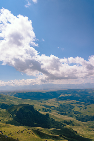 View from the Bermuty Plateau on a summer day. Hills and clouds in the distance. Stock fotó