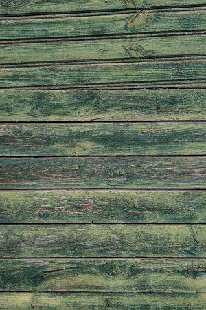 Macro texture d'une clôture en bois avec de la peinture verte fissurée. Banque d'images
