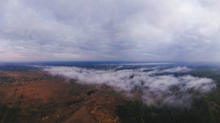 Large panorama of clouds over forests, fields and villages in Russia from the height of the quadrocopter of rain