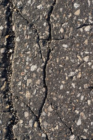 Macro texture of old cracked asphalt