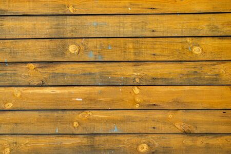 Fond de texture de mur en bois vieille peinture jaune Banque d'images