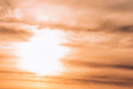 The sun behind beautiful clouds at dawn