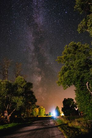 Starry sky with the milky way over the road in the countryside Banco de Imagens