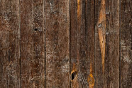 Macro texture of the wall of wooden boards of gray-brown color