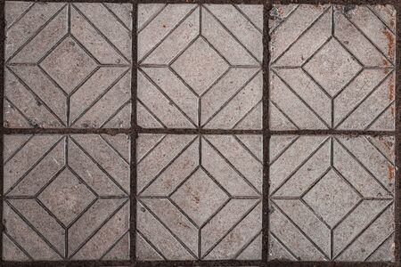 Texture of paving tiles with different geometric shapes