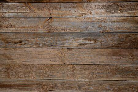 Textur der alten Holzwand mit abblätternder beige Farbe von Brettern