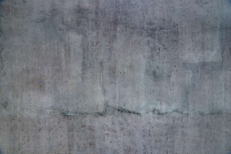 A lot of cracks on the concrete wall texture