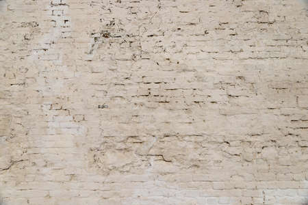 The texture of the old brick wall painted white with peeling paint 版權商用圖片
