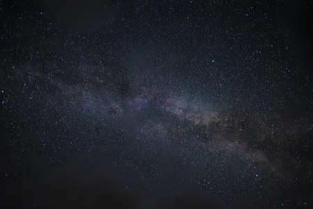The milky way among the clouds 版權商用圖片