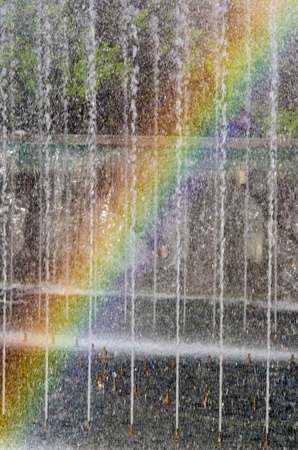 refreshes: In fountain water streams fancifully the rainbow has appeared Stock Photo