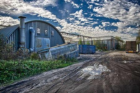 paesaggio industriale: Blue industrial landscape. Industrial warehouse zone under the dramatic sky. Archivio Fotografico