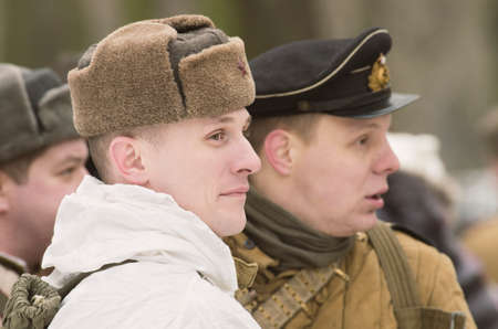 st petersburg: The park Ekaterinhof, St. Petersburg (Russia) - February 23, 2017: Military historical reconstruction of events of World War II. Soviet soldiers awaiting battle formations. Editorial